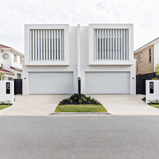 This is an example of a contemporary two-storey white duplex exterior in Gold Coast - Tweed with a flat roof.