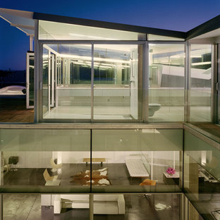 Minimalist glass exterior home photo in San Francisco with a shed roof