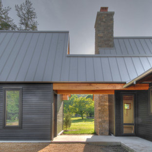 Example of a transitional wood exterior home design in Nashville with a metal roof