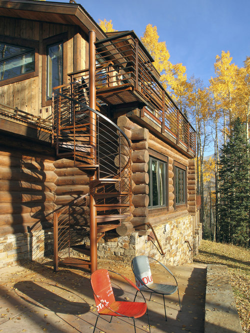 Example Of A Mountain Style Wood Exterior Home Design In Denver