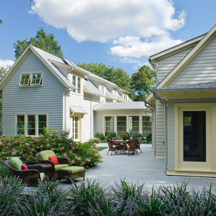 Inspiration for a timeless white wood exterior home remodel in Boston