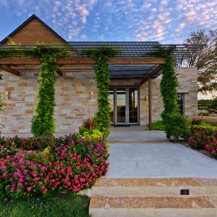 Example of a tuscan one-story brick exterior home design in Dallas