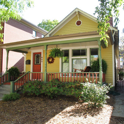 Inspiration for a victorian yellow exterior home remodel in Indianapolis