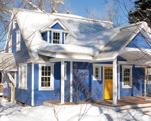 inspiration for a mid sized timeless blue two story vinyl gable roof remodel in