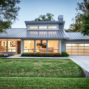 1960s gray one-story concrete fiberboard house exterior photo in Houston with a hip roof and a metal roof