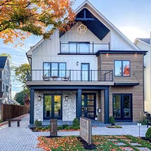 Пример оригинального дизайна: большой, трехэтажный, разноцветный частный загородный дом в стиле лофт с облицовкой из ЦСП, крышей из гибкой черепицы, черной крышей и отделкой доской с нащельником