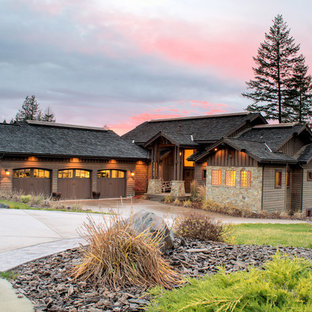 Inspiration for a large craftsman brown two-story wood gable roof remodel in Seattle