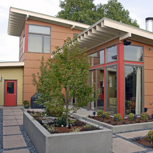 Photo of a contemporary two-storey orange exterior in Portland.