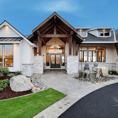 Huge country white two-story mixed siding exterior home idea in Portland with a shingle roof