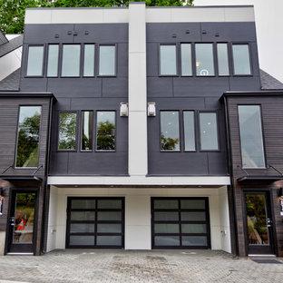 Diseño de fachada de casa pareada negra, moderna, de tamaño medio, de tres plantas, con revestimientos combinados y tejado plano