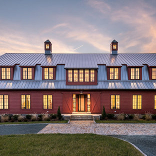Country red two-story wood house exterior idea in Richmond with a gambrel roof and a metal roof