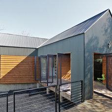 Contemporary Exterior by MINGUELL-MCQUARY, LLC