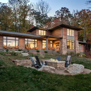 Inspiration for a large modern brown three-story wood exterior home remodel in Other with a shingle roof