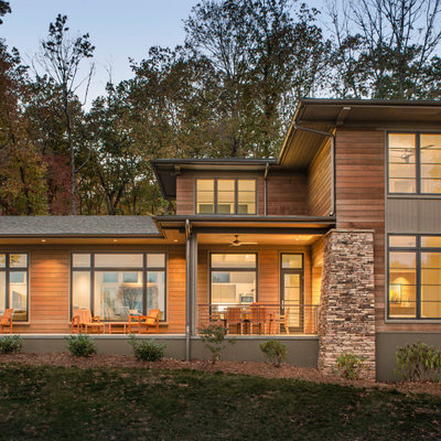 Example of a large minimalist brown three-story wood exterior home design in Other with a shingle roof