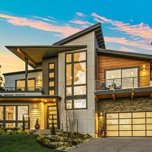 Diseño de fachada de casa multicolor, escandinava, grande, de dos plantas, con revestimientos combinados, tejado plano y tejado de varios materiales