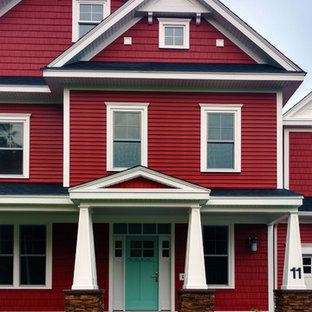 Inspiration for a large arts and crafts two-storey red exterior in Boston with concrete fiberboard siding and a gable roof.