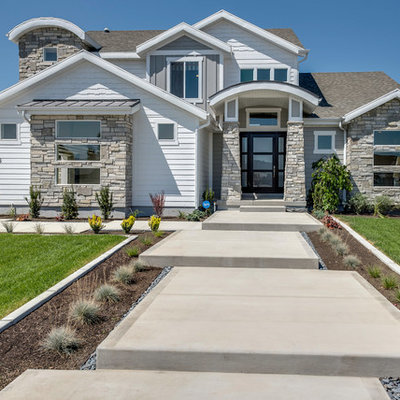 Large arts and crafts white two-story mixed siding exterior home photo in Salt Lake City with a shingle roof