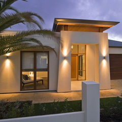 tropical exterior by Scott Salisbury Homes