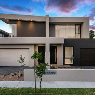 Cette image montre une façade de maison double design.