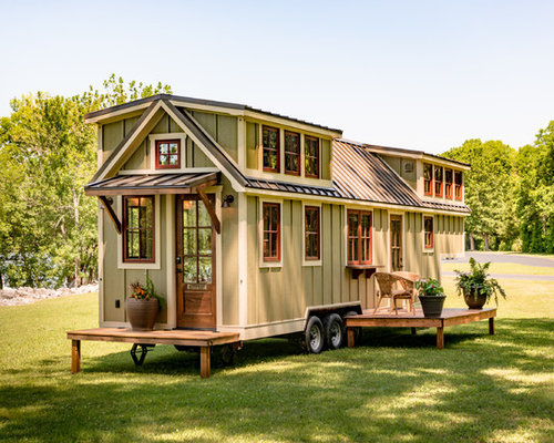 inspiration for a small craftsman green one story wood gable roof remodel in other with