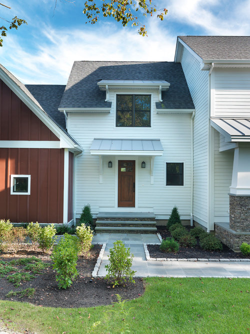 Example Of A Country Two Story Wood Exterior Home Design In Providence