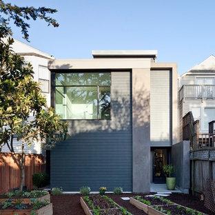 Ejemplo de fachada gris, ecléctica, de tamaño medio, de dos plantas, con revestimiento de hormigón y tejado plano