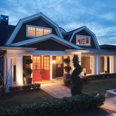 Example of a mid-sized ornate two-story wood exterior home design in Seattle with a gambrel roof