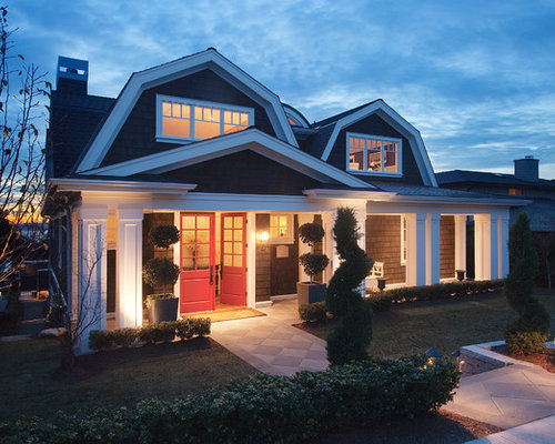 example of a mid sized ornate two story wood exterior home design in seattle