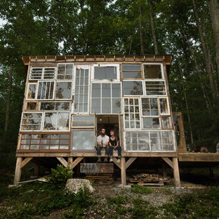 Photo of a bohemian glass house exterior in Other.