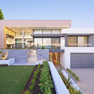 Mid-sized contemporary two-storey white house exterior in Perth with a flat roof, mixed siding and a metal roof.