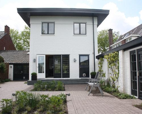 Elegant White Brick Exterior Home Photo In Amsterdam