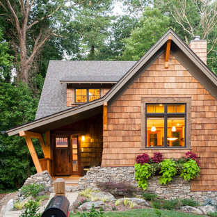 Elegant wood exterior home photo in Other