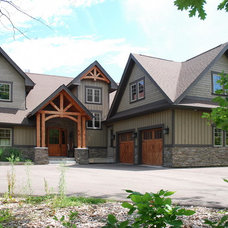 Rustic Exterior by STONE CUSTOM HOMES