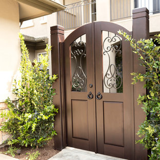 Example of a tuscan beige house exterior design in Los Angeles