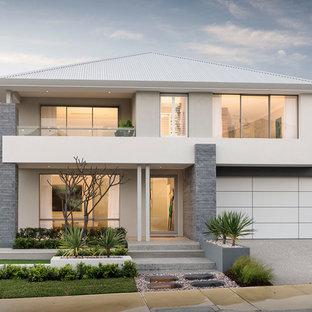 Idéer för att renovera ett funkis grått hus, med två våningar, blandad fasad, valmat tak och tak i metall