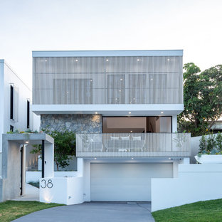 Inspiration for a mid-sized contemporary two-storey white house exterior in Brisbane with a metal roof, mixed siding and a flat roof.