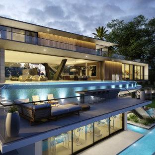 Modelo de fachada de casa gris, minimalista, extra grande, de tres plantas, con revestimiento de hormigón, tejado plano y techo verde