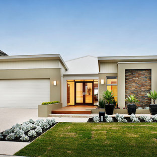 Design ideas for a contemporary one-storey beige house exterior in Perth with a flat roof and a mixed roof.
