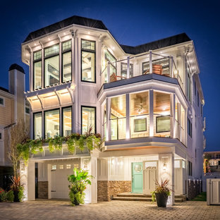Inspiration for a beach style white three-story exterior home remodel in Other