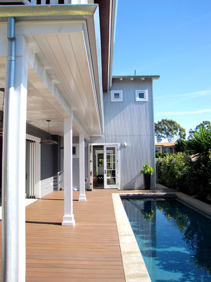 Beach Style Exterior by Tara Bussema - Neat Organization and Design