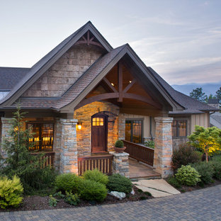 Mountain style beige two-story mixed siding exterior home photo in Other