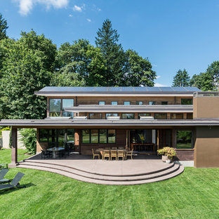 Inspiration for a contemporary brown house exterior remodel in Portland