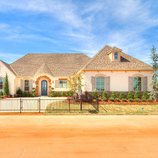 Example of a transitional pink exterior home design in Oklahoma City