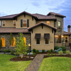 Traditional Exterior by Celebrity Communities
