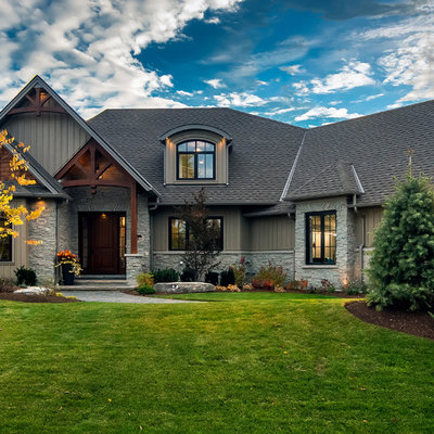 Example of a large arts and crafts gray two-story mixed siding exterior home design in Toronto with a hip roof