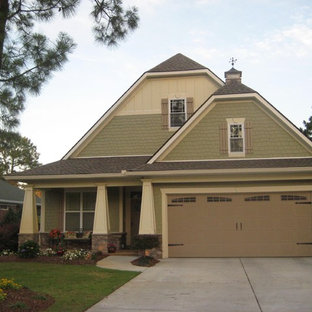 Arts and crafts exterior home photo in Charlotte with a clipped gable roof