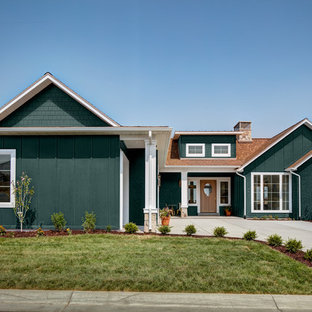 Elegant green one-story mixed siding exterior home photo in Salt Lake City with a shingle roof