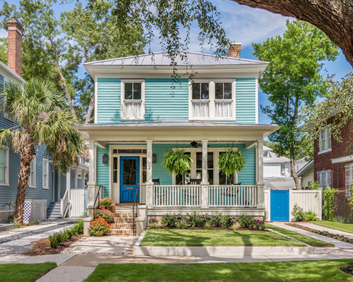 elegant blue two story wood exterior home photo in charleston with a hip roof and
