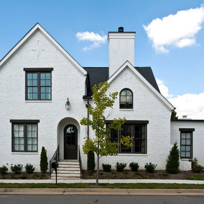 Inspiration for a timeless white two-story brick exterior home remodel in Nashville