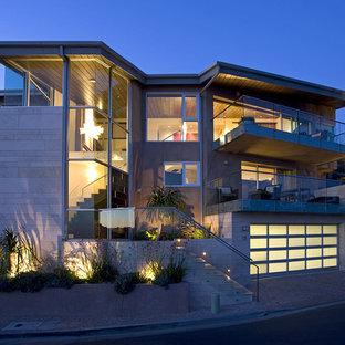 Trendy three-story mixed siding flat roof photo in Los Angeles